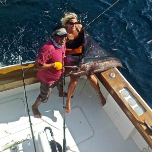 oger Cascante helping guest catch the fish